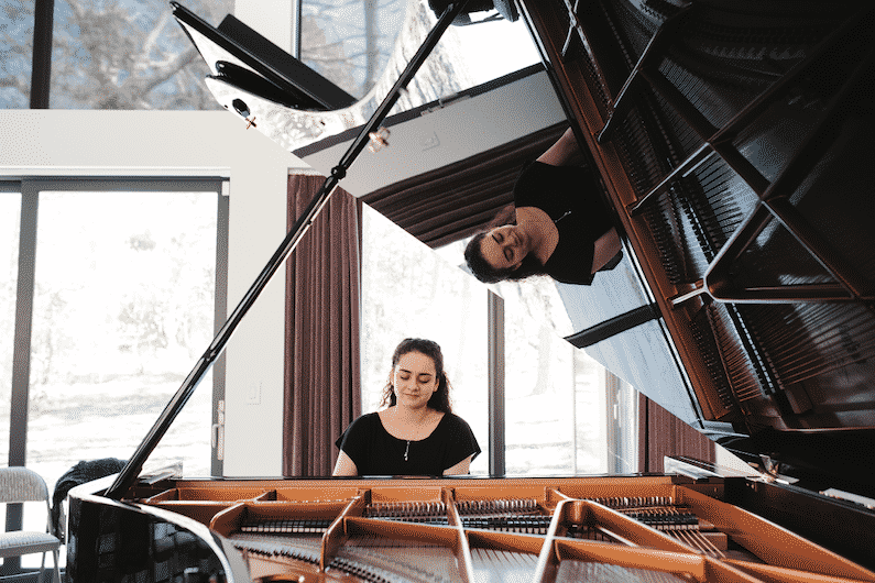 Aleksandra Kasman, 23, plays a Bösendorfer 280 Vienna Concert Series concert grand piano during a Chapel Hill Piano Salon.