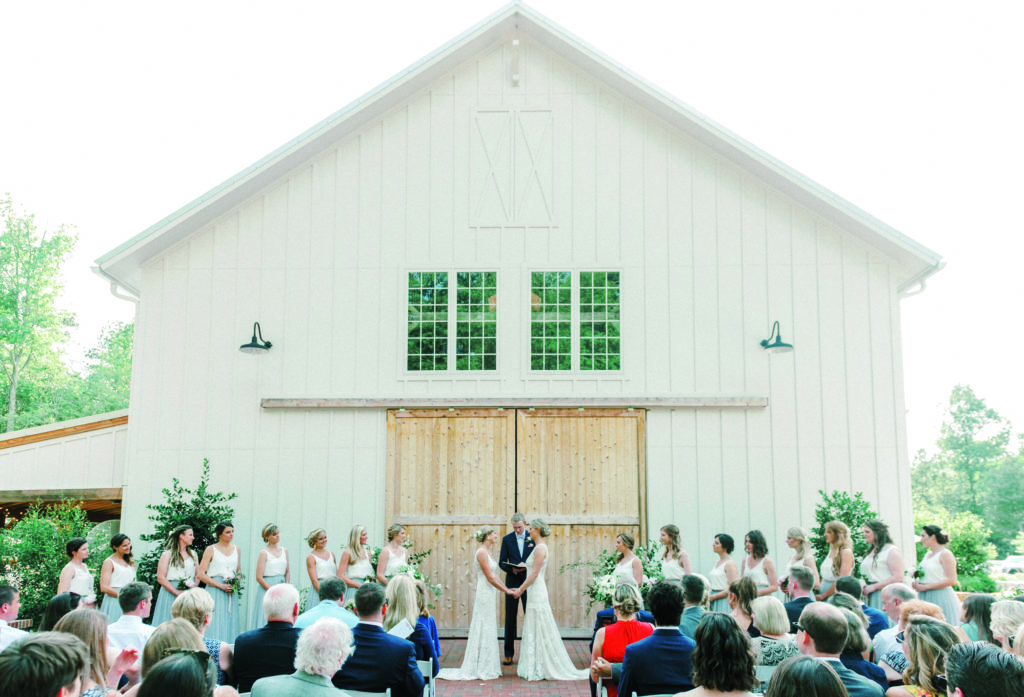 Kristine and Paige Falk at their wedding at The Barn of Chapel Hill at Wild Flora Farm