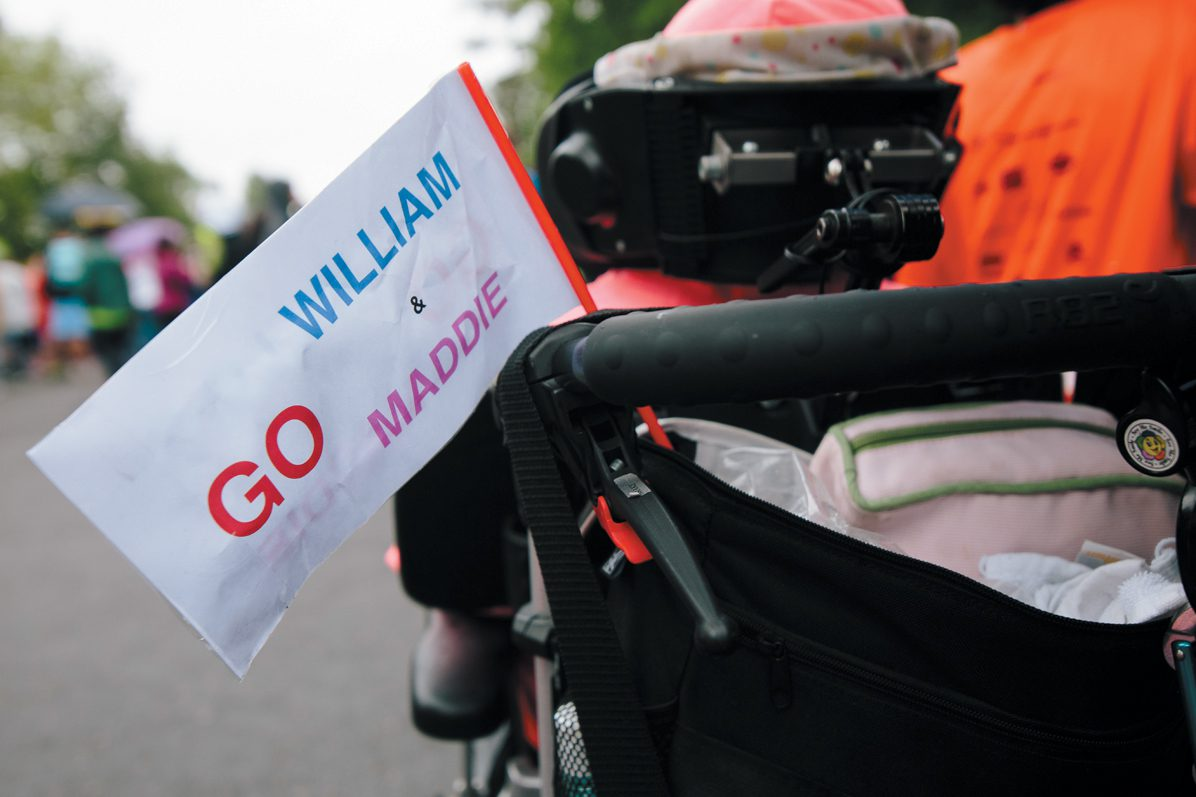 A flag on a stroller was just one of the many signs and banners for the duo.
