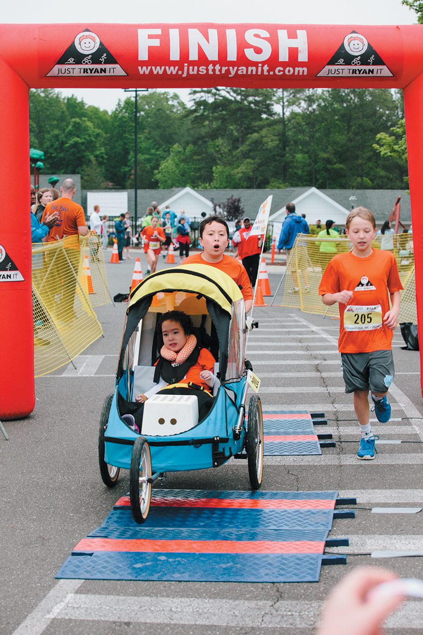 William and Maddie at the finish line – and the crowd went wild!