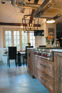 Beyond the range, the reclaimed-wood-and-local-iron table was handmade by Bull City Designs in Durham.