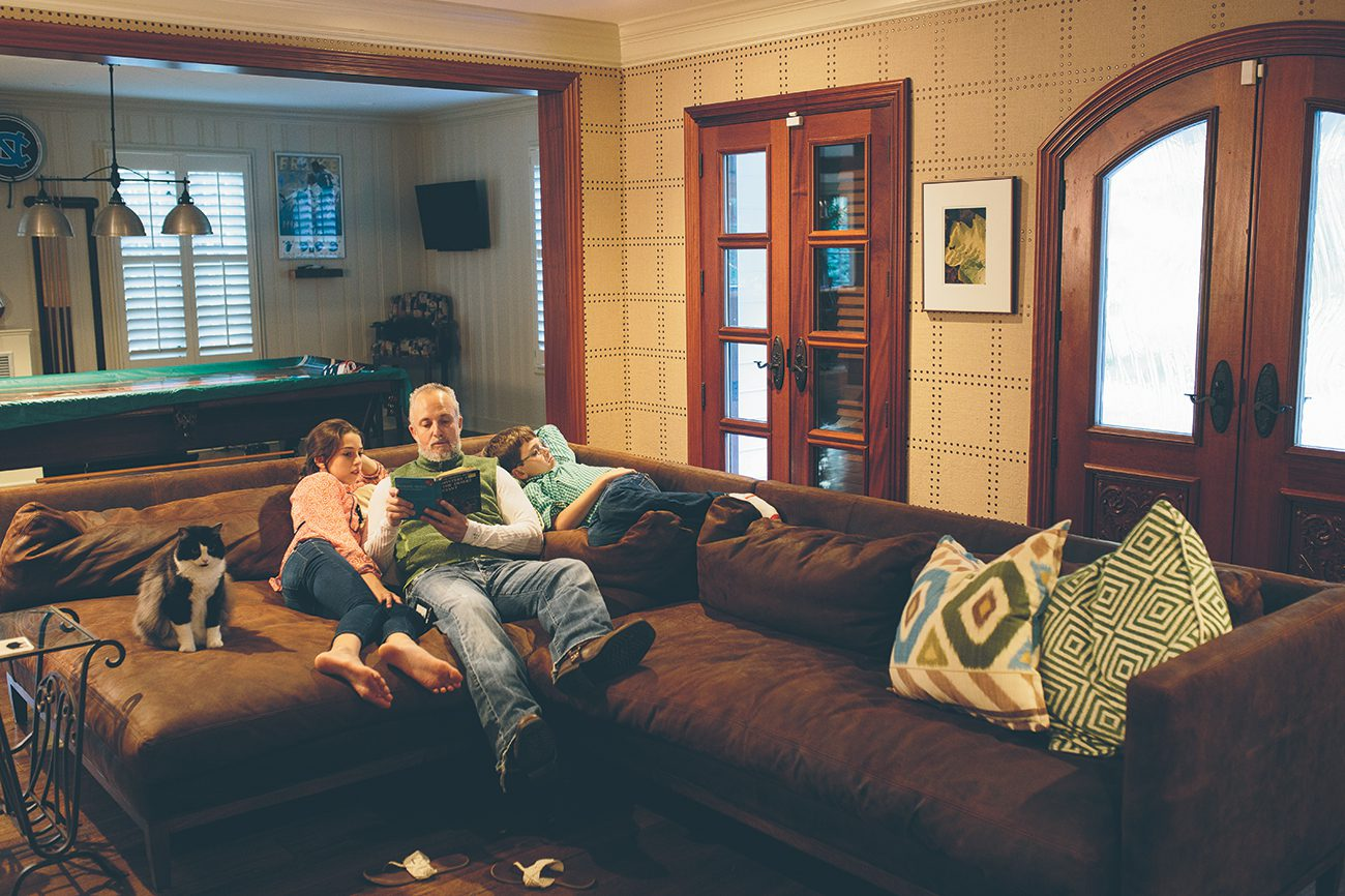 Jeremy Salemson's oversize sofa makes the perfect spot for reading to his daughter, Kate, 12, and son, James, 11.