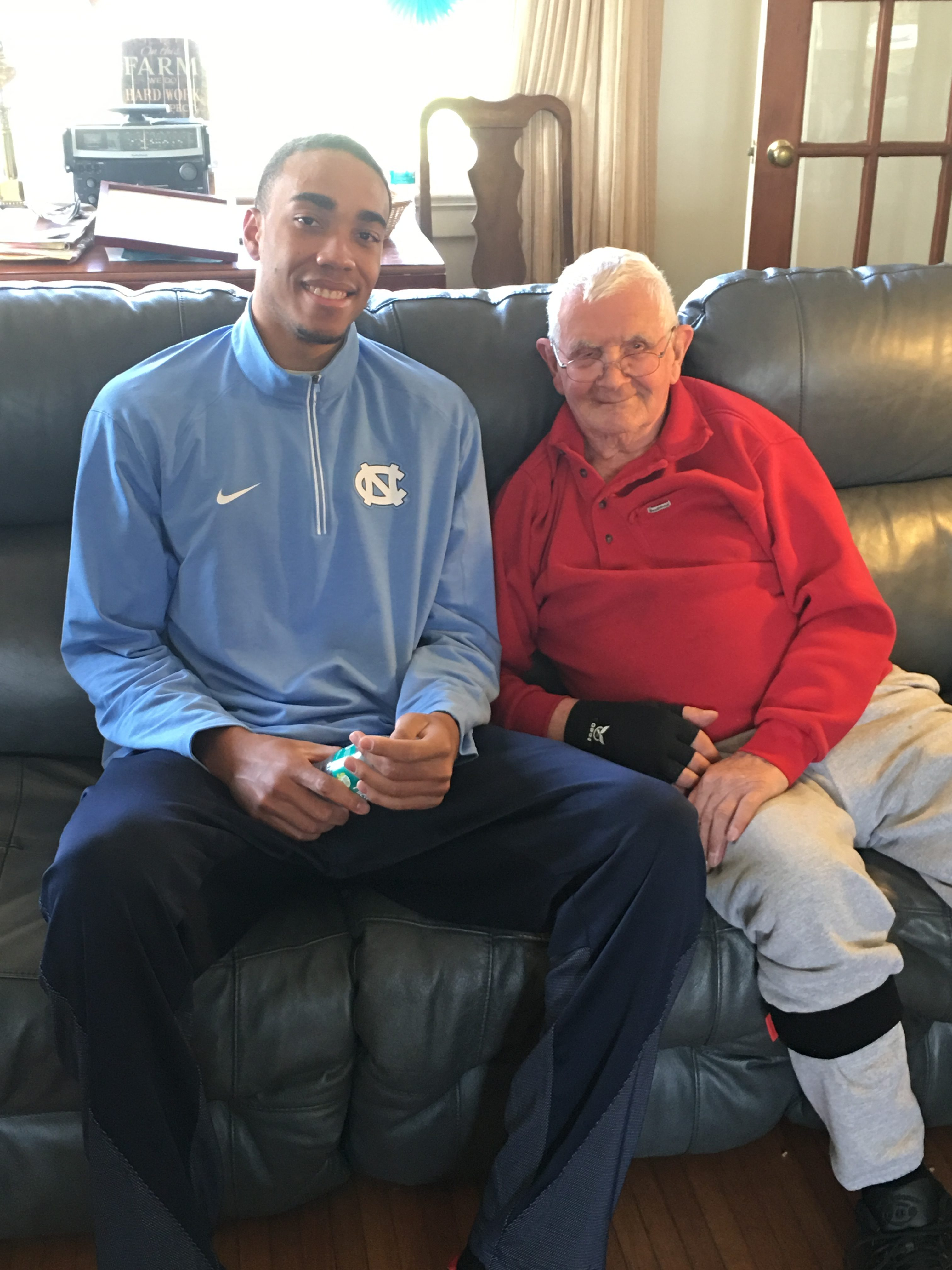 UNC's Brice Johnson visited Maple View Farm in April, where he met with Bob and milked one of the cows.