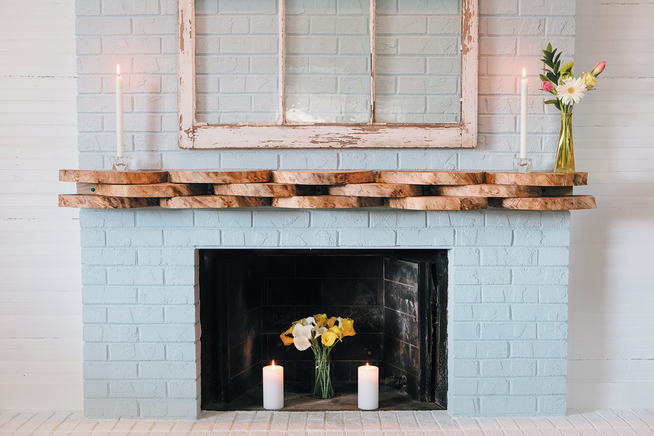 """""""Who doesn't want a little Carolina blue in their house?"""" asks Kate. Alex made the mantel out of the wood rounds that were used as centerpieces at the couple's wedding."""