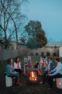 Kate, Casey Linke, Alex, Jay Linke, Leslie Wiseman and Wes Heymann hang out in the backyard. Alex, Wes and Jay graduated from Chapel Hill High in 2001.