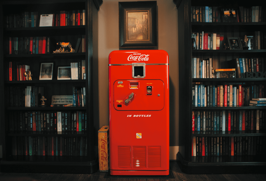 """Chris has a vintage Coca-Cola vending machine in his office. """"That's been in my family since the 1950s. It's always a good conversation starter."""" He keeps coins in an old metal tin atop the vending machine so guests can fetch a drink when they visit."""