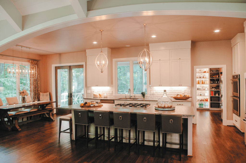 The floor-to-ceiling cabinets in the kitchen give the Woodfins plenty of storage –not that they need it with a dream pantry a few feet away.
