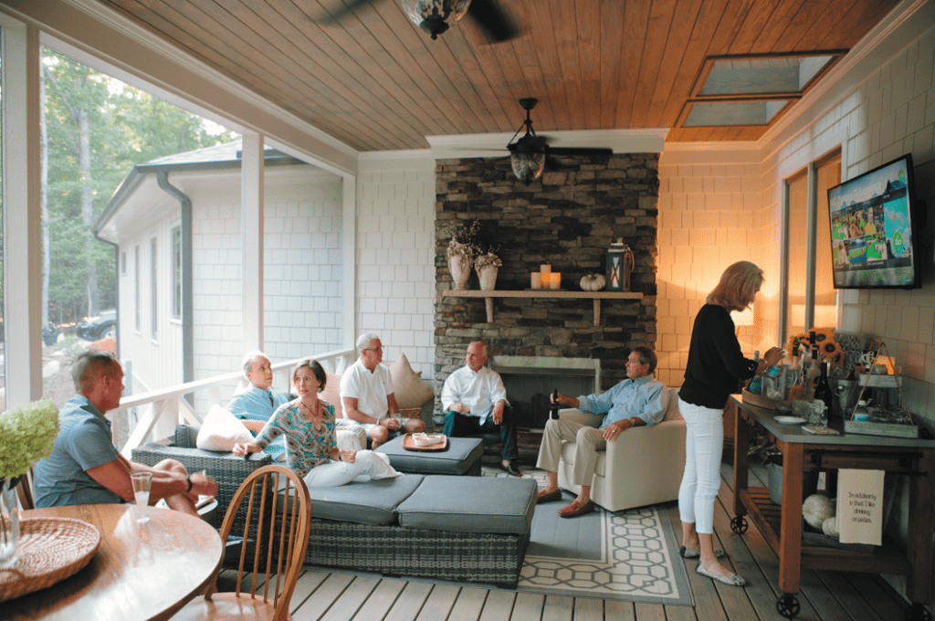 """The porch is Terry's favorite place in the house. With fireplace, TV and bar, it's a cozy spot for entertaining –or to enjoy alone. """"I like to go out there and catch the evening news and have a glass of wine,"""" she says."""