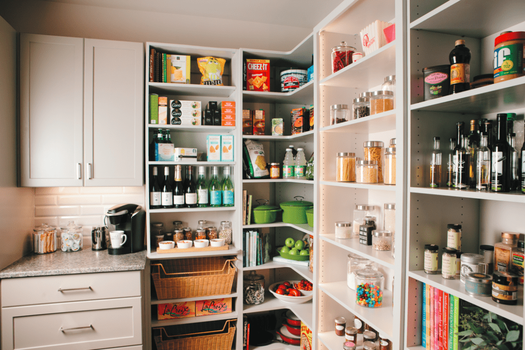 """The pantry is Pinterest-worthy with a backlit shelf beckoning you to snacks in glass jars. Besides being pretty, it's practical for entertaining. """"I can see everything out in front of my, and I know when my supply is low of anything,"""" Terry says."""