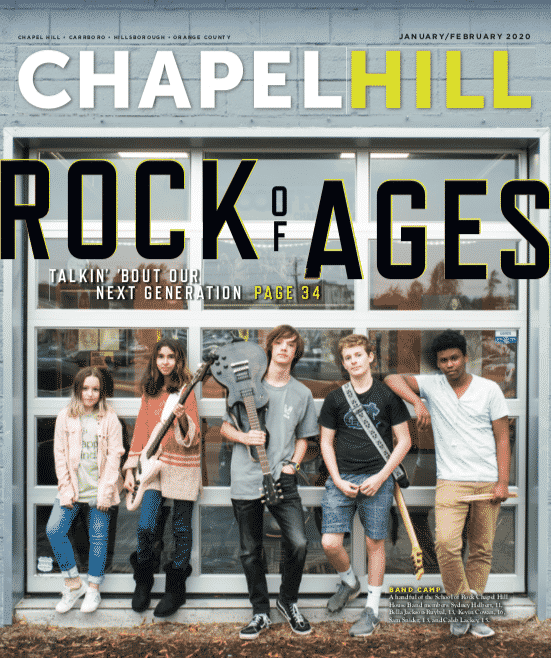 Members of the School of Rock Chapel Hill house band in front of the music school.