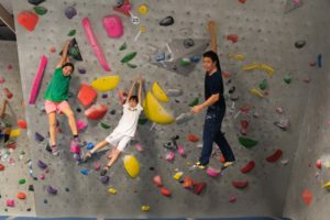 Rebecca and Theo, with their dad Andrew, on the wall at Progression Climbing