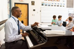 Culbreth Middle School choir teacher Michael Jones brings an engaging energy to his classroom.