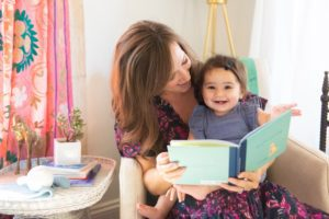 Anna Routh Barzin reads to her daughter, Ruth