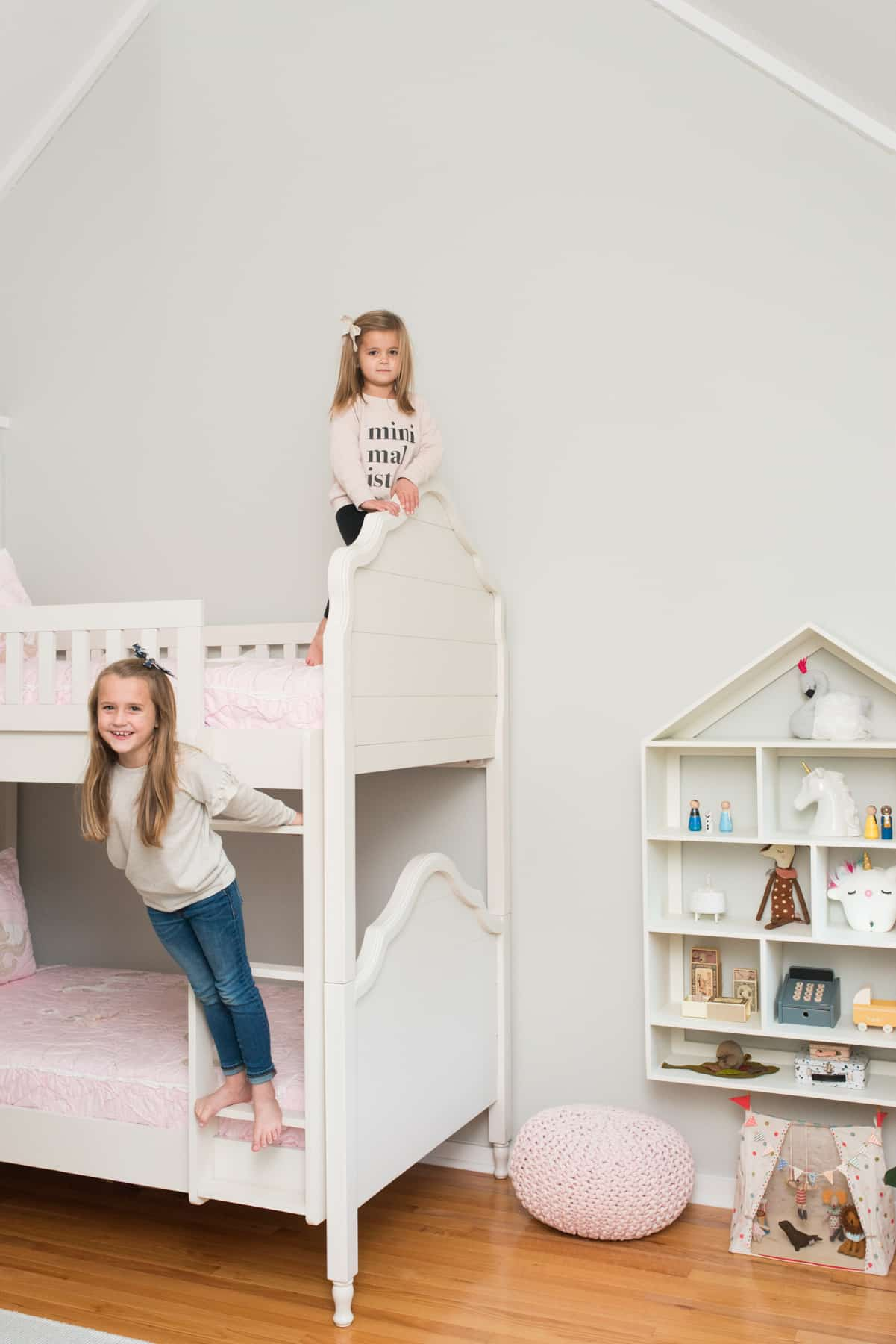 Kadence and Avery Jade use the house-shaped bookshelf both for play and for storage.