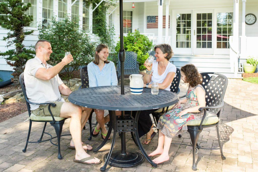The Johnson family enjoys refreshments on their back porch