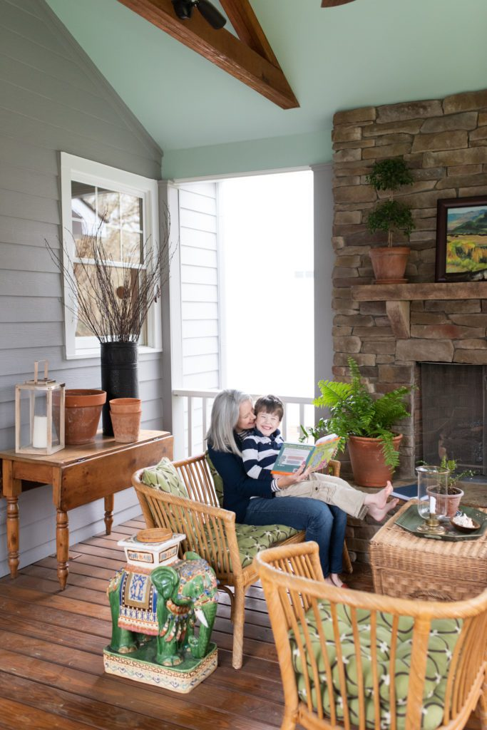 Ashlyn Goldberg holds one of her sons on the family's screened in porch