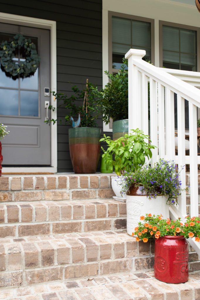 The stairway leading to the Kast home features bright and colorful flowers