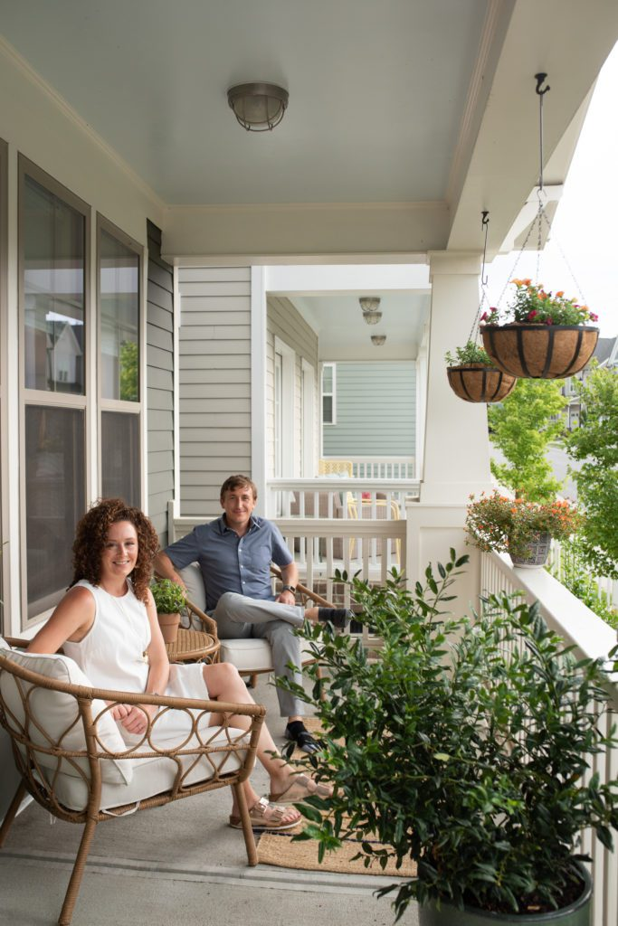 Max and Krystal Kast sit on the front porch of their Briar Chapel Home