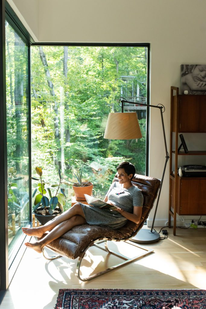 Custom-built home – A woman sits in a chair reading