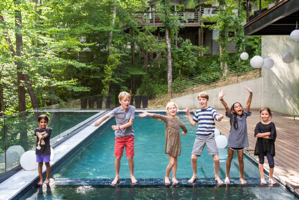 Custom-built home – Children stand in front of a custom pool in Chapel Hill