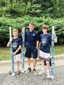 Porter, Zac and James with storage tubes they keep bracelets on
