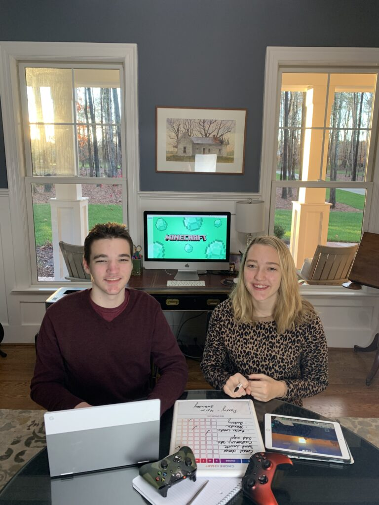 Harrison and Sophie Stanley in front of their Minecraft screen