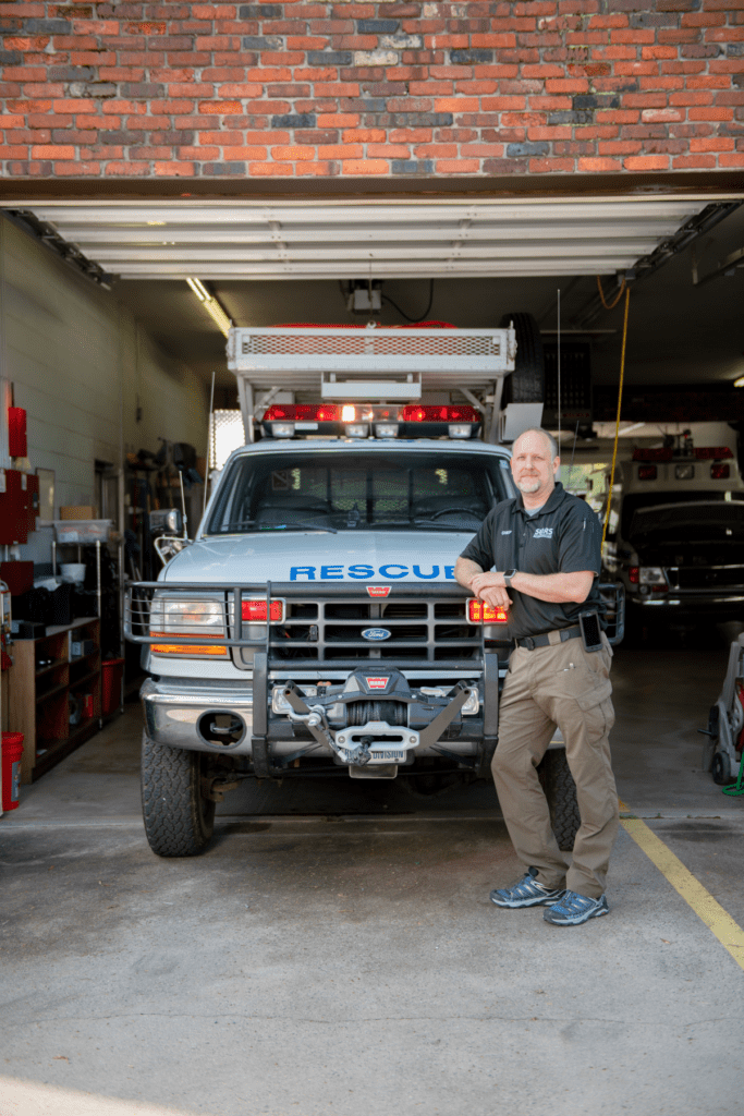 Man standing in front of a rescue vehicle